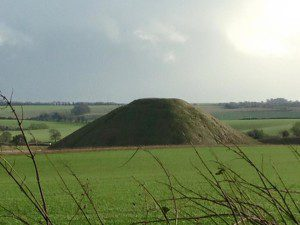 Silbury Hill - the ancient burial mound that stands nearby Avebury